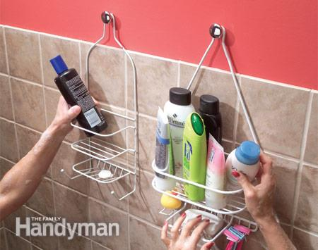 Use cabinet knobs to hang extra shower caddies. Works for tub toy baskets too! - TriciaGoyer.com