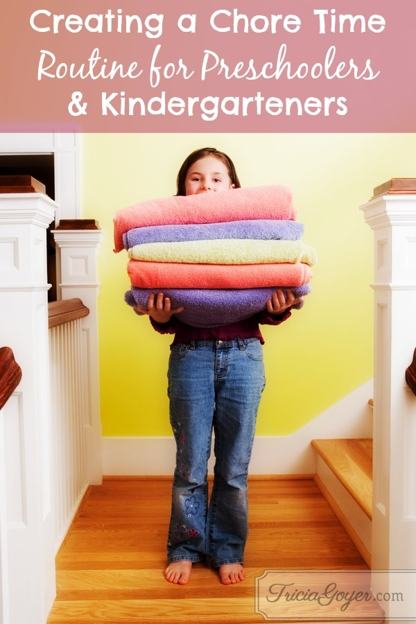 Young girl with stack of towels on stairs