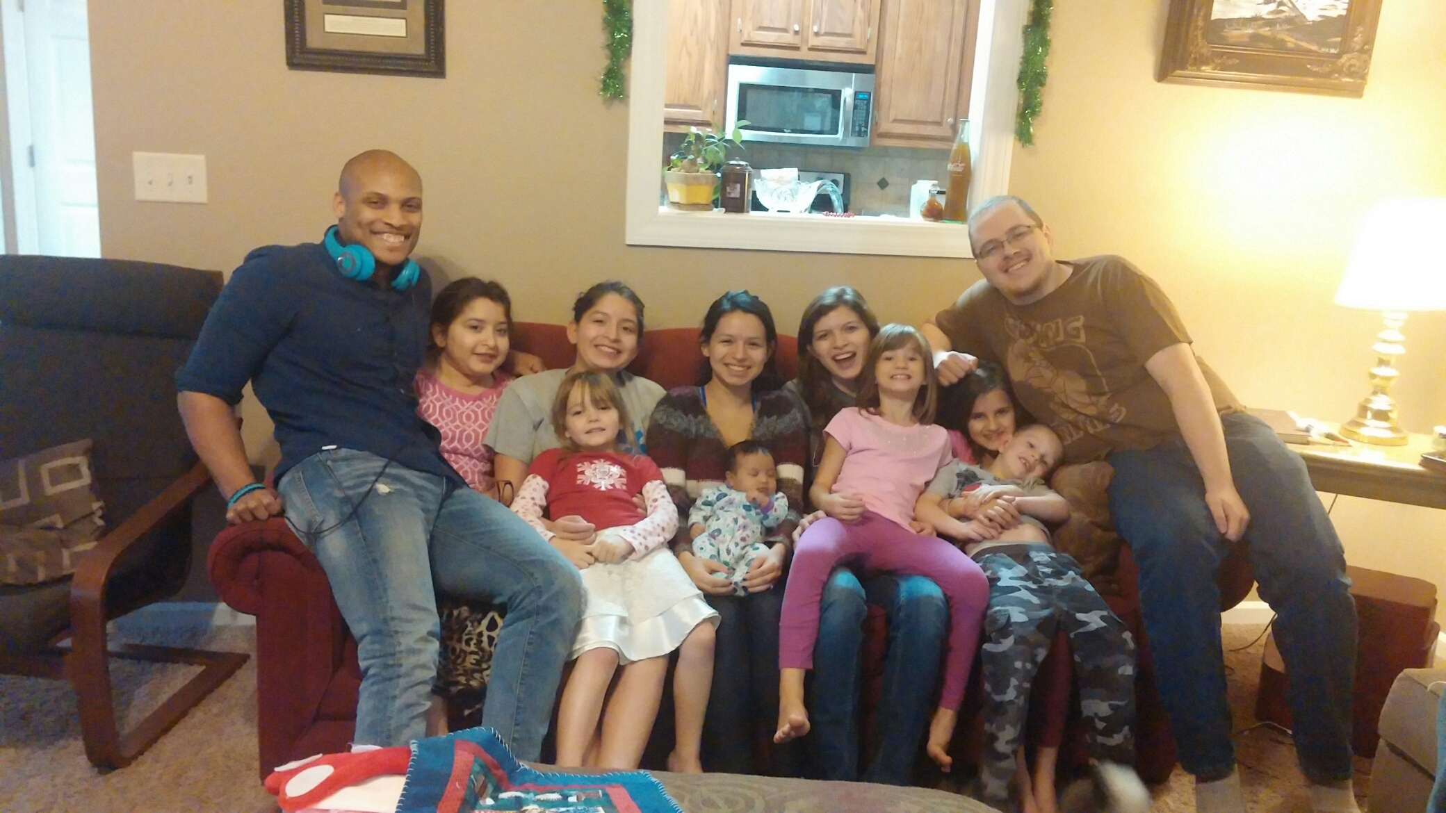 photo from Thanksgiving on couch, November 2015 We also get a BONUS daughter, son-in-law and grandbaby! Our girls have an old sister. She is married to Regi and they have a sweet new baby girl On couch from left to right: Regi, Lauren, Jordan Lili, Maria, Floentina, and Nathan on laps: Alyssa, Maya, Bella and Casey